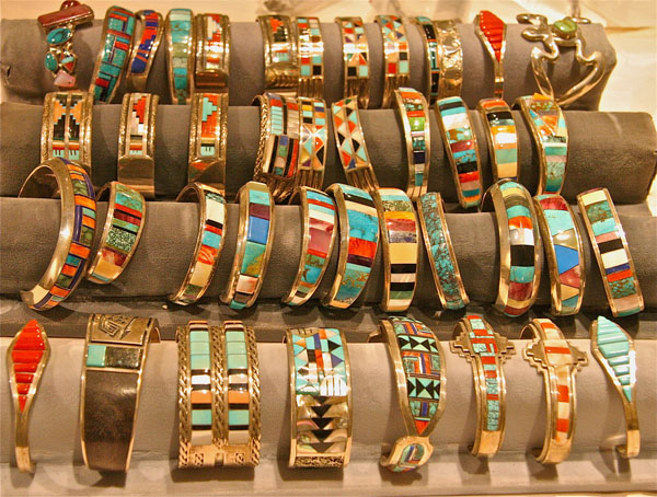 Rows of silver bracelets made by Hopi, Zuni and Navajo artists